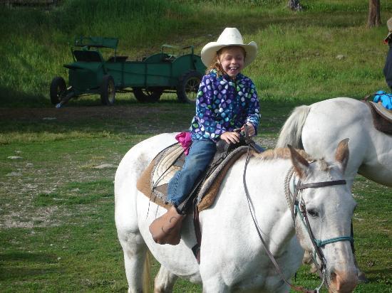 "Nine Quarter Circle Ranch: ""Rough rider"" on her horse"