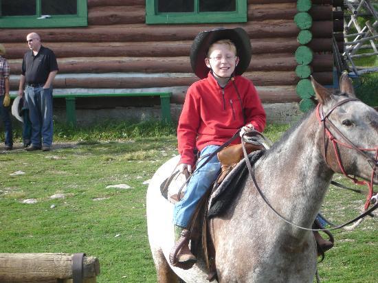 "Nine Quarter Circle Ranch: ""Rough rider"" on his horse"