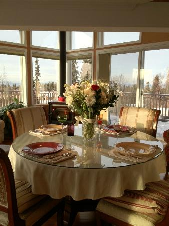 Alaska Sundance Retreat Bed and Breakfast, LLC: A recent view of the dining room with the addition of the wood stove!