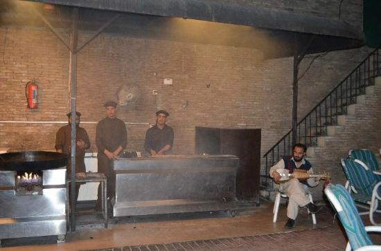 KHIVA Restaurant: Grill boys in action with musical accompaniment