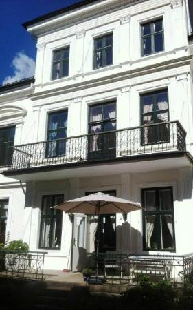 Ellingsens Pensjonat: Our lovely Pensjonat from the outside on a summer day. Experience a summer in Oslo with us! We a