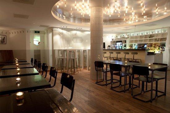 Photo of Modern European Restaurant Piet de Gruyter at Van Limburg Stirumplein 4-6, Amsterdam 1051 BE, Netherlands