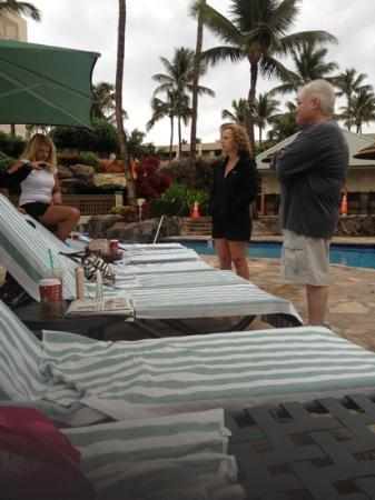Marriott's Maui Ocean Club - Molokai, Maui & Lanai Towers: Three people guarding 16 chairs at 6:15am.