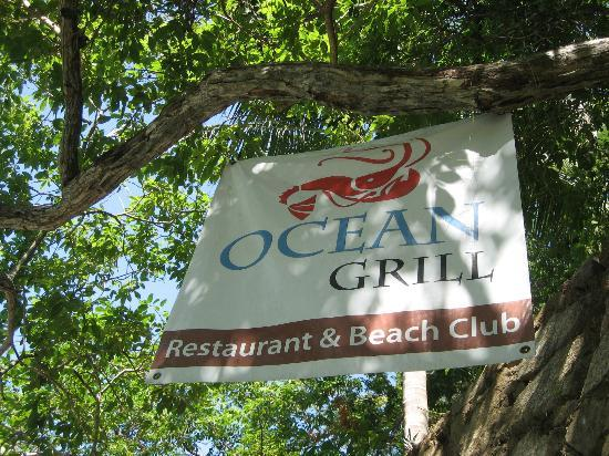 Ocean Grill Restaurant & Beach Club: Sign hanging on the trees as you walk to Los Colomitos beach. They have snorkeling equipment!