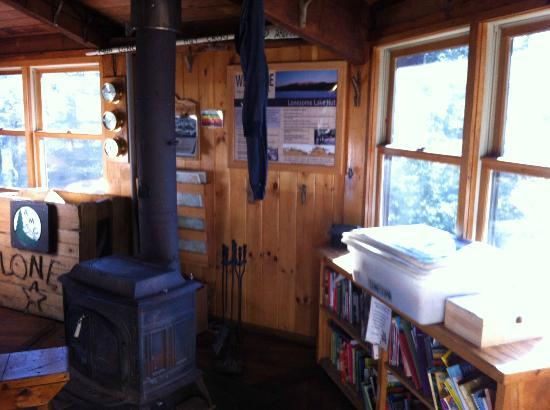 Lonesome Lake Hut: The wood burning stove and the library