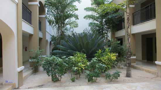 Now Larimar Punta Cana: Gardens between adjacent wings in our block of rooms