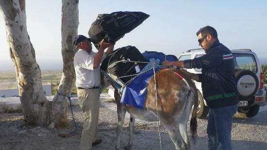 Georgis Apartments: Georgi and helper loading luggage onto donkey