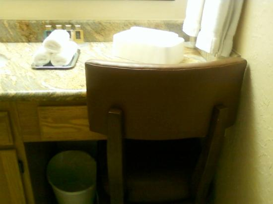 Villas de Santa Fe: Kitchen chair is used in vanity as there is no room for it in the kitchen.