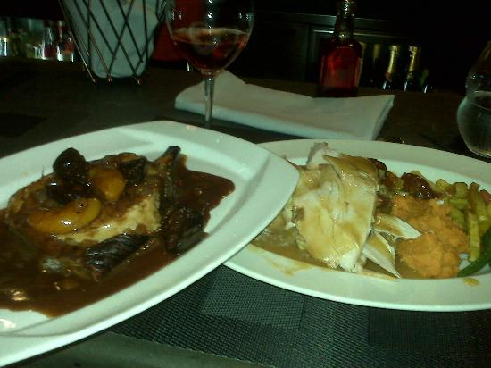 Baci Cafe & Wine Bar: Thanksgiving dinner - Pork on the left and Turkey on the right - both Fantastic!