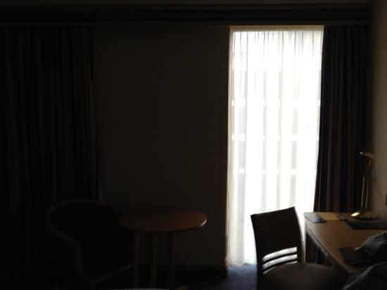 Hilton London Gatwick Airport: very small window - all wall behind the curtain.
