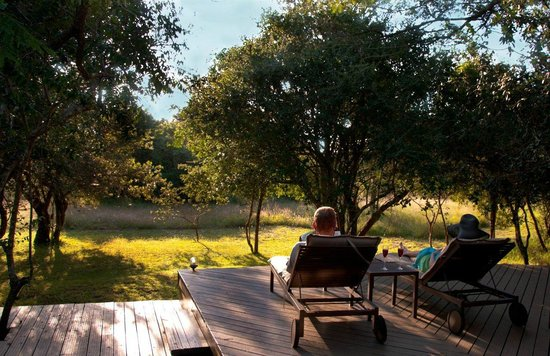 Bushwillow Collection: Lodge_Game viewing on loungers on the main lodge deck