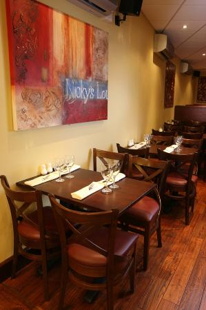 Nicky's Fish Bar & Restaurant: Table beneath Artwork
