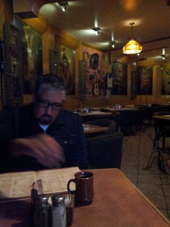 El Potrero Carnes : My husband checking out the menu