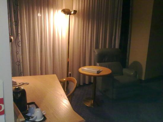 Four Points by Sheraton Brussels : Standard single room has desk and armchair. Bed is just outside the picture
