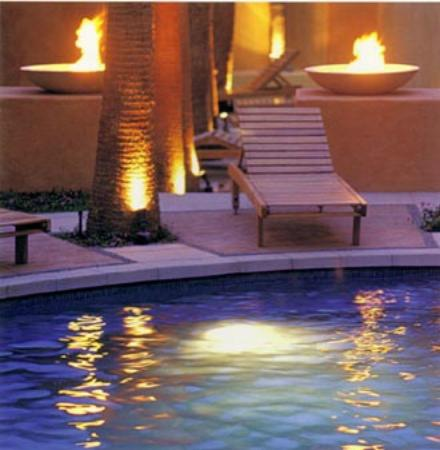Casa Natalia: Night pool view with fire pits