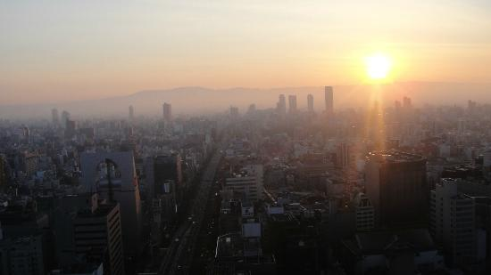 Hotel Monterey Grasmere Osaka: the sunrise view from my room at 22nd floor
