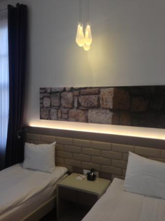 Puding Marina Residence: beds with cool art & cooler lights