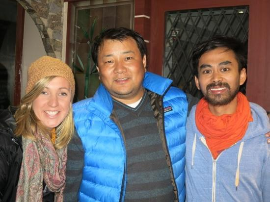 Magnolia Residency: us with the amazing owner Chewang Sherpa in the reception area.