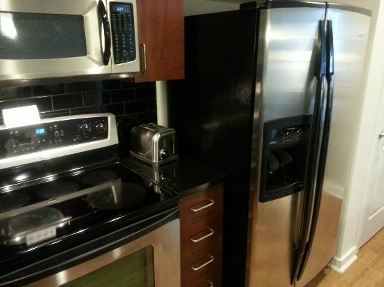 Twelve Atlantic Station: Microwave, Range, Toaster, and Refridgerator with Icemaker and Water Dispenser.