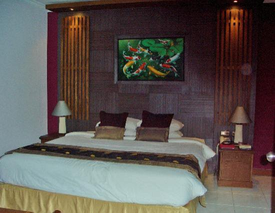 Risata Bali Resort & Spa: Bedroom in Junior suite