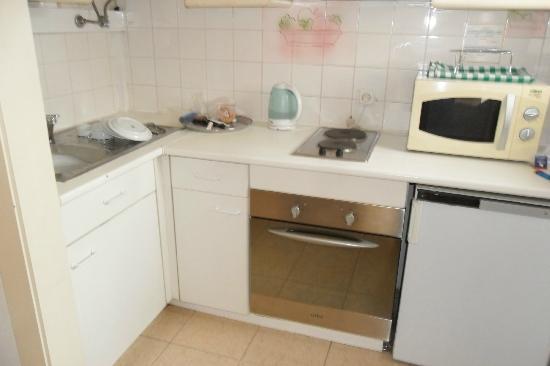 Apartamentos Mouraliz: Kitchen