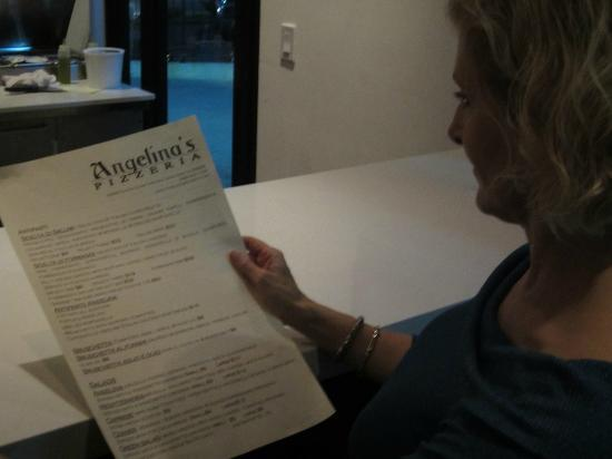 Angelina's Pizzeria: Guest looking at Menu