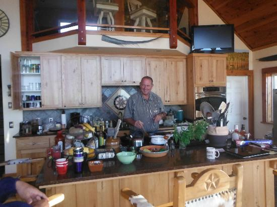 Somewhere Over the Rainbow Lodge: Gerry cooking for us