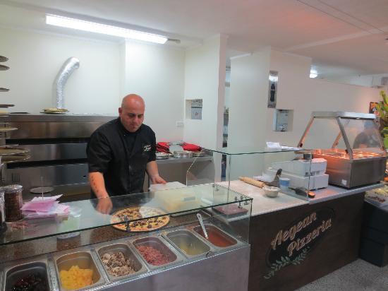 AEGEAN LANE : Aegean Pizzeria owner making our pizza