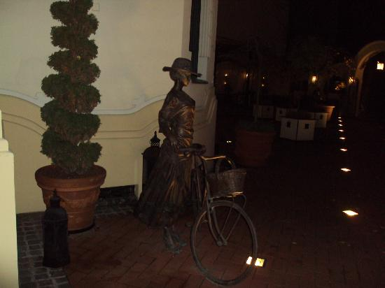 Boss: A lovely missy with her bicycle (frozen bronze life)