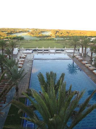 Sofitel Essaouira Mogador Golf & Spa: View from room - pool, golf course and water beyond