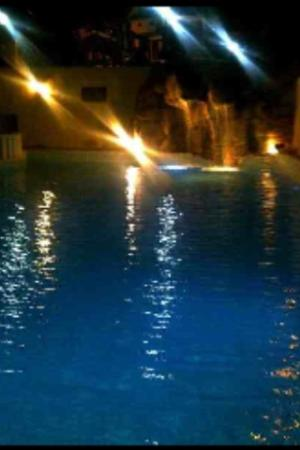 Sincerity Apart Hotel: Pool At Night With Waterfall On Beautiful