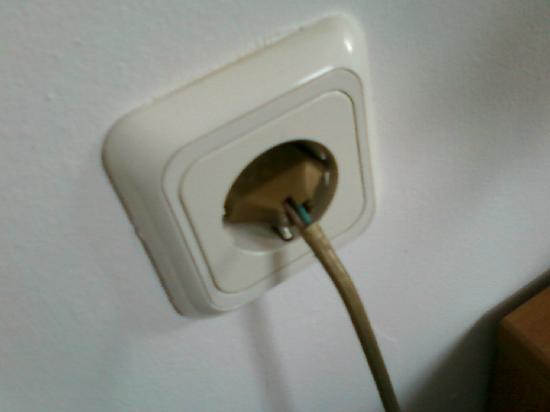 Nestorion Hotel: don't touch that plug (it's for the nightstand light, right next to the bed)