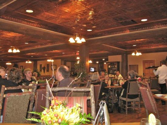 Dobyns Dining Room: Warm glow of hammered copper ceilings