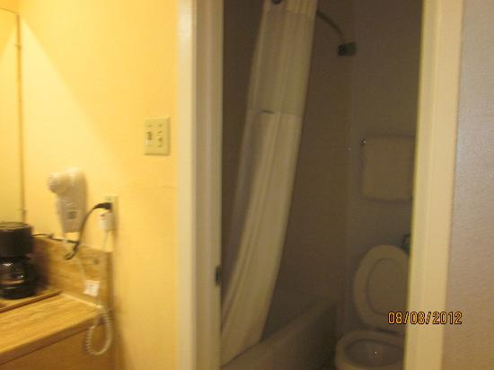 Super 8 Austin Downtown/Capitol Area: left is sink and mirrorm large area, restroom to the right.