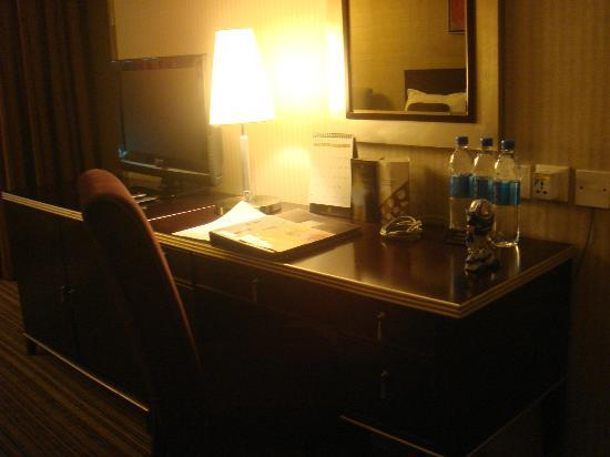 Park Hotel Hong Kong: dimly lit room with 2-bedside lamp, foyer, writing desk, couch area all lit up!