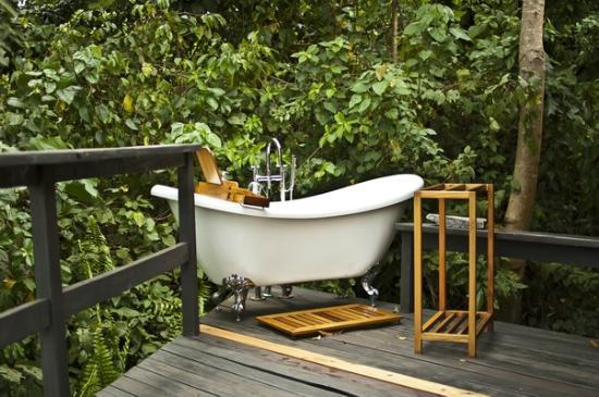 all cottages have bathtubs on the terrace - picture of wildwaters
