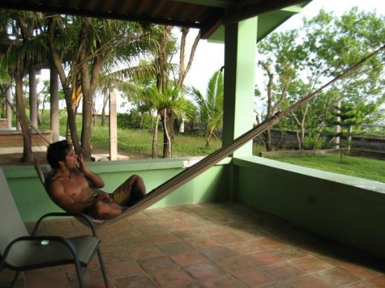 Popoyo Beach Lodge: My husband enjoying the hammock