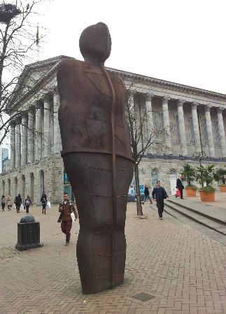 The Iron man in Victoria square with Birmingham town hall in the background
