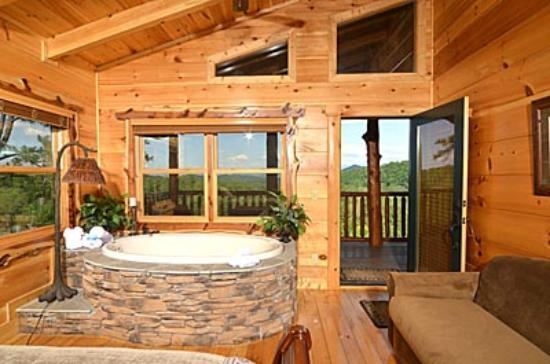 Smoky Cove Chalet and Cabin Rentals: Private indoor whirlpool tub bedroom with 35 mile view