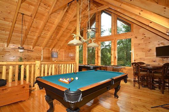 Smoky Cove Chalet and Cabin Rentals: Huge game rooms with pool tables, air hockey, arcade games, and foosball