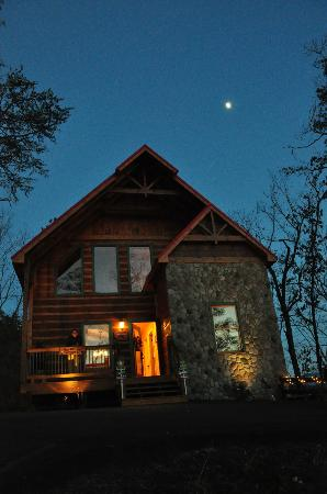 Accommodations by Parkside Resort : Log Cabin at night