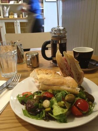 Henri: delicious Brie and ham baguette, some good French coffee. Perfect lunch.