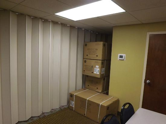 Quality Inn & Suites: Boxes shoved into the corner of the meeting room I rented for a baby shower.