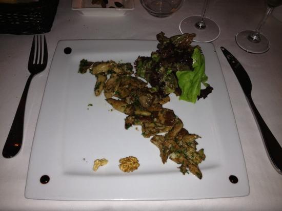 COSMOPOLITAN RESTAURANT : Cepes sautéed with Garlic
