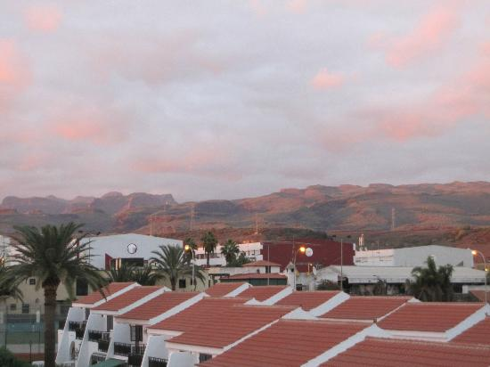 Hotel Parquemar: View of mountains in the background of the hotel from front door of studio apartment at sunset