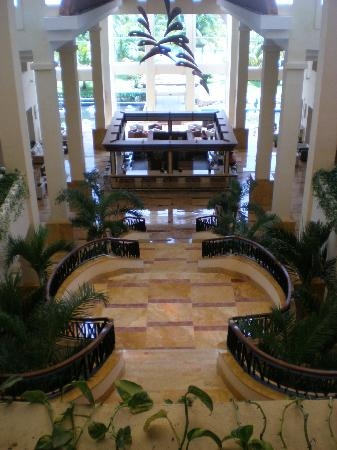 Excellence Playa Mujeres: View from 1st floor down to 'Martini Bar' in hotel lobby