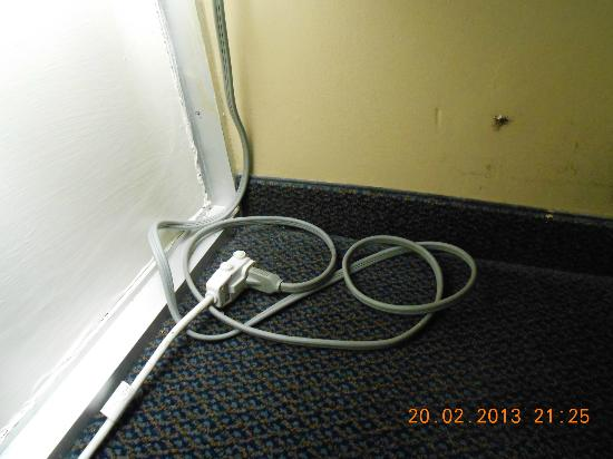 Bermuda Sands Motel: AC unit plugged into extension cord laying in floor