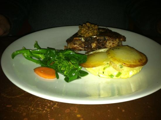 Backdoor Kitchen & Catering: pork chop with olive tapenade