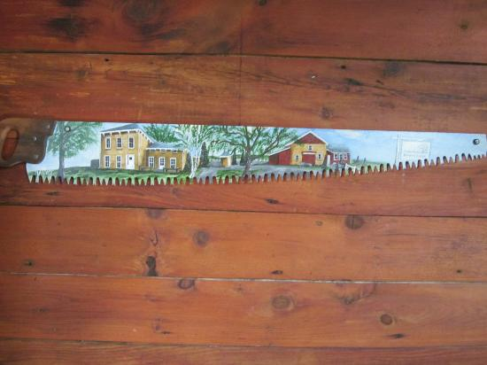 Quivey's Grove : a painting of the Main House & Stable Grill on a saw