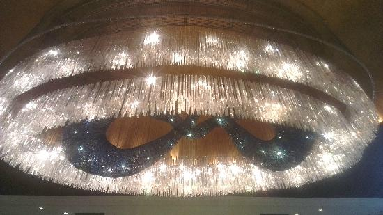 Royal Garden Hotel: A Large Glass Chandelier in Recption Area